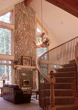Picture of circular staircase in the great room of the model P-801 house plan.